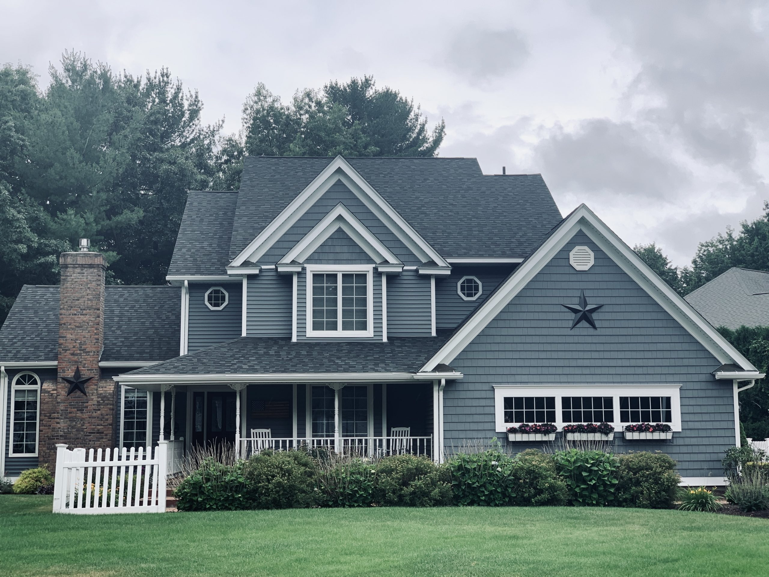 Front view of a home with new windows and a new roof