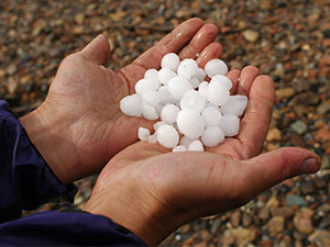 large hailstones shown in hands of a peron